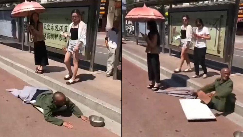 Thanh niên giả tàn tật ăn xin bị cô gái lật tẩy